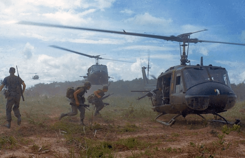 "Photo: U.S. Army Bell UH-1D helicopters airlift members of the 2nd Battalion, 14th Infantry Regiment from the Filhol Rubber Plantation area to a new staging area, during Operation ""Wahiawa,"" a search and destroy mission conducted by the 25th Infantry Division, northeast of Cu Chi, South Vietnam, 16 May 1966"