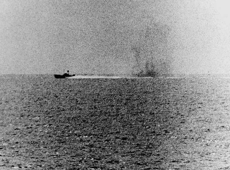 Photo: photograph taken from the U.S. Navy destroyer USS Maddox (DD-731) during the engagement with three North Vietnamese motor torpedo boats in the Gulf of Tonkin, 2 August 1964