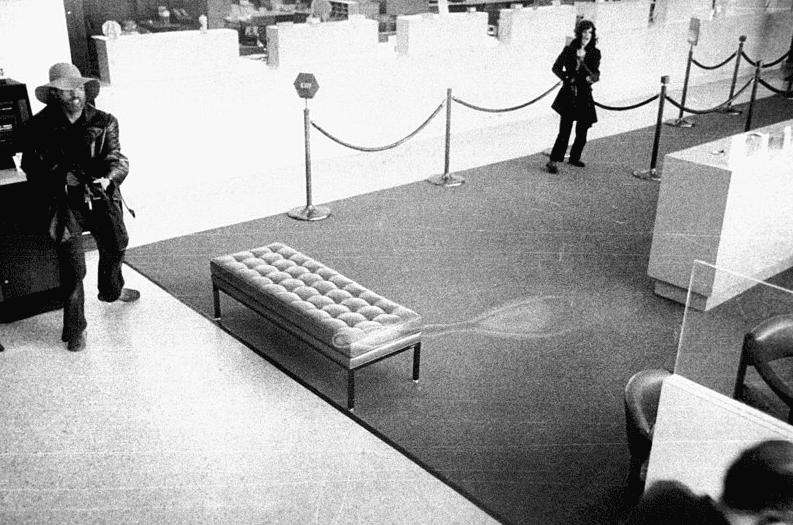 Photo: Patty Hearst yelling commands at bank customers at the Hibernia bank, San Francisco, California, 15 April 1974