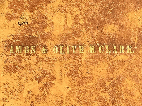 Photo: cover of the family Bible of Amos and Olive Clark.