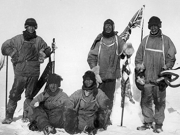 Photo: Captain Robert F. Scott's party at the South Pole, 18 January 1912. L to R: (standing) Wilson, Scott, Oates; (seated) Bowers, Edgar Evans. Credit: Wikimedia Commons.