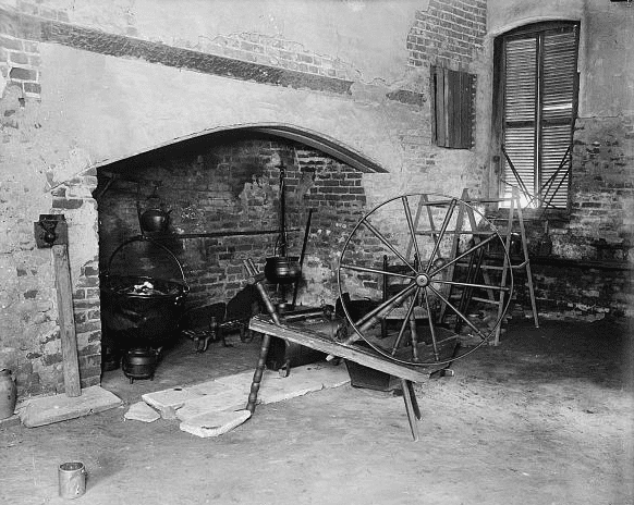 Photo: large fireplace and spinning wheel, Westmoreland County, Virginia