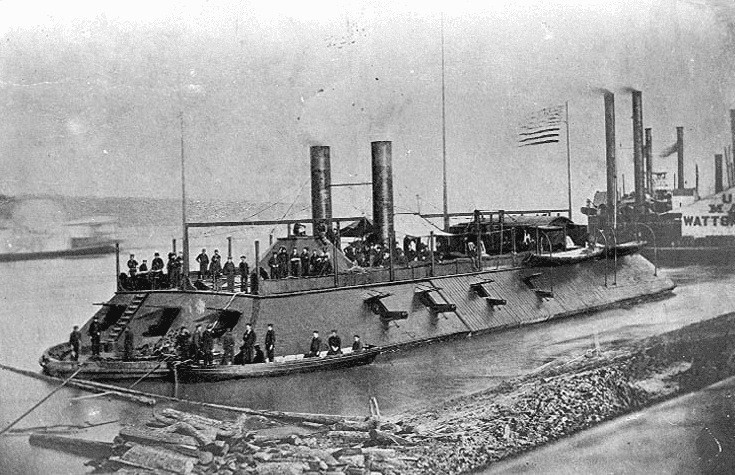 Photo: USS Cairo in the Mississippi River area during 1862, with a boat alongside her port bow, crewmen on deck and other river steamers in the background
