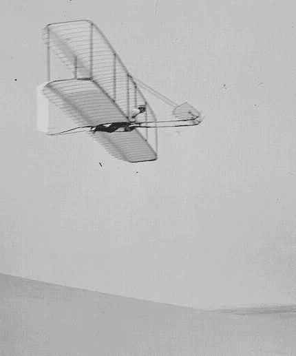 Photo: Wilbur Wright piloting the 1902 glider over the Kill Devil Hills, North Carolina, 10 October 1902