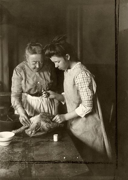 "Photo: ""Woman and Girl Preparing Goose,"" 1915"