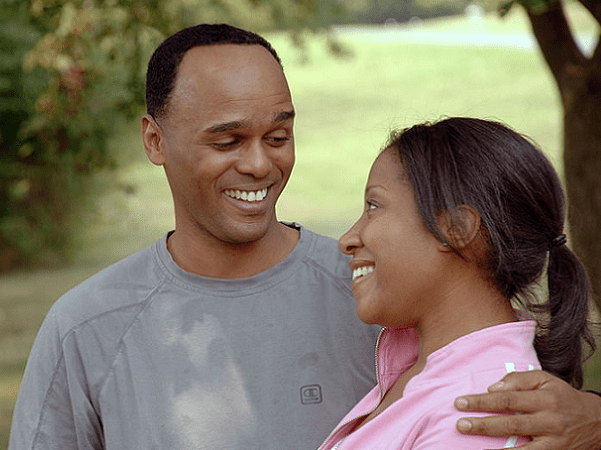 Photo: an African American couple in a park. Credit: Bill Branson; Wikimedia Commons.