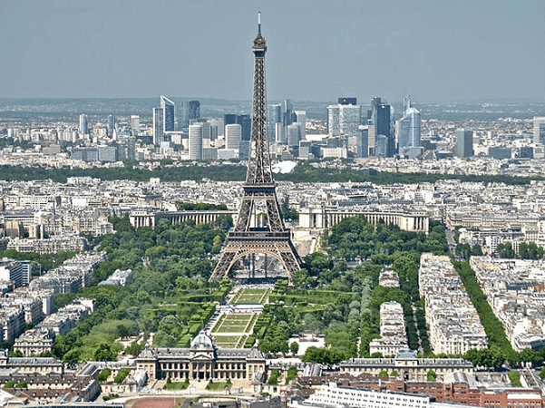 Photo: the Eiffel Tower and the La Défense district, Paris. Credit: David McSpadden; Wikimedia Commons.
