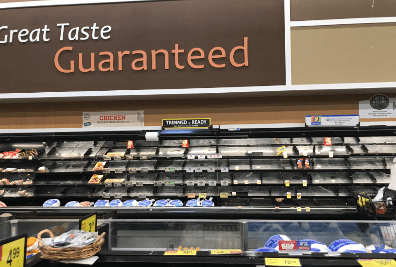 Photo: depleted shelves at a grocery story