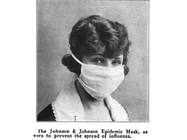 Photo: woman wearing a flu mask, 1919. Credit: Red Cross.