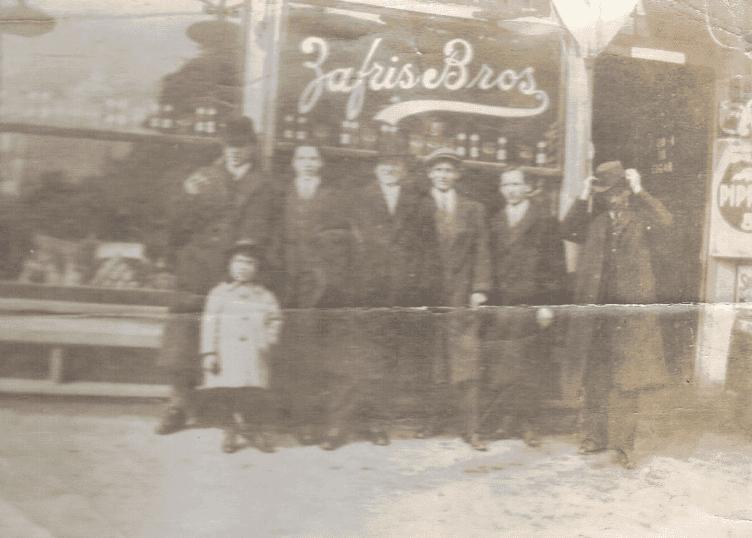 "Photo: Zafris family in front of the ""Zafris Bros"" store, Newburyport, Massachusetts"