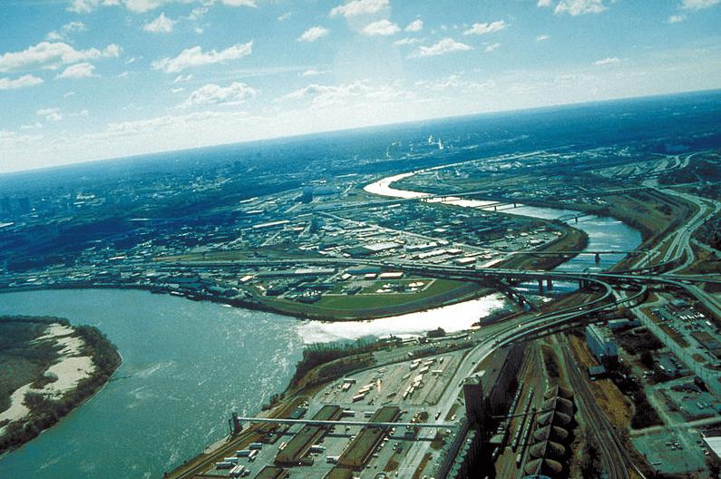 Photo: aerial view of Kansas City, Kansas, looking southwest. The Kansas River (right-center) joins the Missouri River (left)
