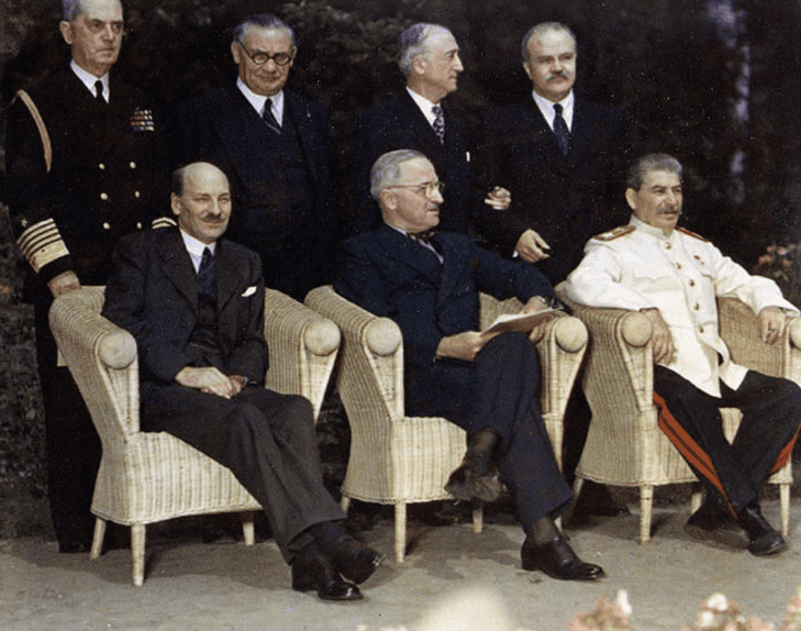 Photo: sitting at the Potsdam Conference (from left): Clement Attlee, Harry S. Truman, Joseph Stalin, and behind: Fleet Admiral William Daniel Leahy, Foreign Secretary Ernest Bevin, Secretary of State James F. Byrnes, and Foreign Minister Vyacheslav Molotov, July 1945