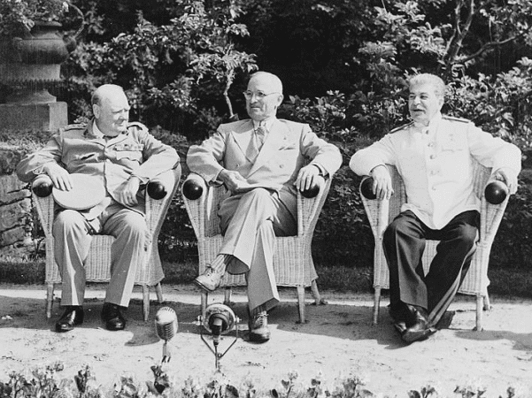 Photo: (L to R) British Prime Minister Winston Churchill, President Harry S. Truman, and Soviet leader Josef Stalin in the garden of Cecilienhof Palace before meeting for the Potsdam Conference in Potsdam, Germany, 25 July 1945. Credit: National Archives and Records Administration.