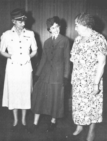 Photo: in 1946, Mrs. Opha Johnson (far right), the Marine Corps' first woman Marine, and former Director of Women Marines, Colonel Katherine A. Towle (far left), admire the uniform worn by Mrs. Johnson, modeled by PFC Muriel Albert