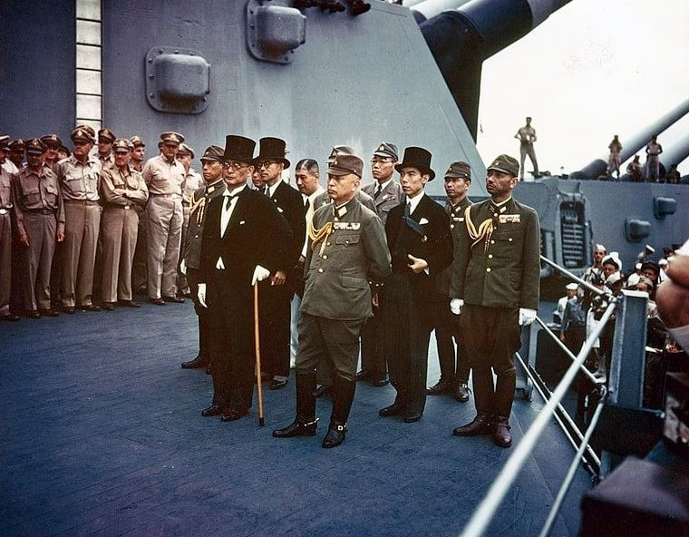 Photo: representatives of the Empire of Japan stand aboard USS Missouri prior to signing of the Instrument of Surrender, 2 September 1945