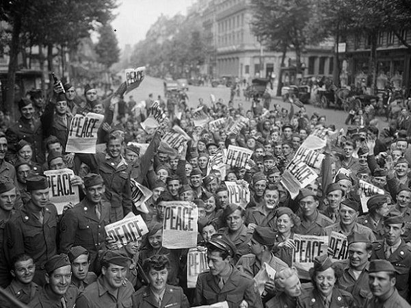 Photo: allied military personnel in Paris celebrating V-J Day on 15 August 1945. Credit: National Archives and Records Administration; Wikimedia Commons.