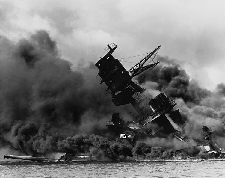 Photo: the USS Arizona burning after the Japanese attack on Pearl Harbor, 7 December 1941