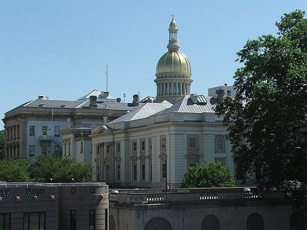 Photo: the New Jersey State House in Trenton, New Jersey. Credit: Marion Touvel; Wikimedia Commons.