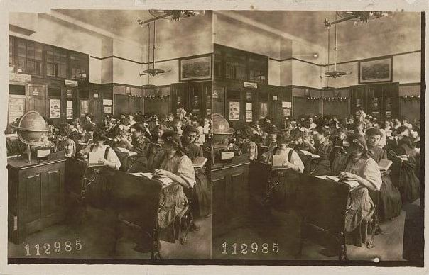 "Photo: ""Girls in Classroom Viewing Stereographs through Stereoscopes,"" stereo photo, c. 1908"