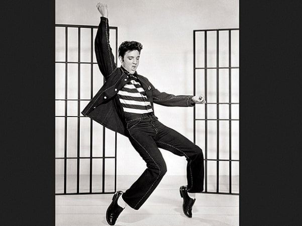 "Photo: Elvis Presley in a publicity photo for the 1957 film ""Jailhouse Rock,"" Credit: Metro-Goldwyn-Mayer, Inc.; Wikimedia Commons."