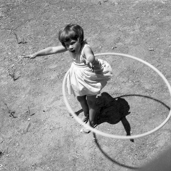 Photo: girl twirling a hula hoop, 1958