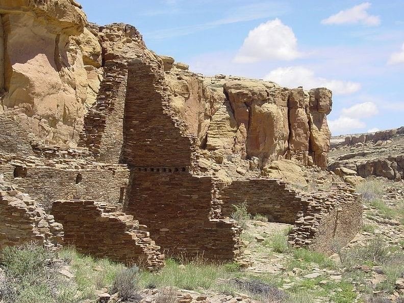 Photo: Hungo Pavi, located in the central portion of Chaco Canyon, New Mexico. A staircase can be seen leading out of the complex