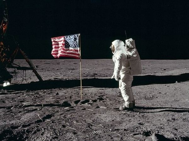 Photo: Astronaut Buzz Aldrin, Lunar Module pilot of the first lunar landing mission, poses for a photograph beside the deployed United States flag during an Apollo 11 Extravehicular Activity (EVA) on the lunar surface, 20 July 1969; photo taken by Neil Armstrong. Credit: Credit: National Aeronautics and Space Administration (NASA); Wikimedia Commons.