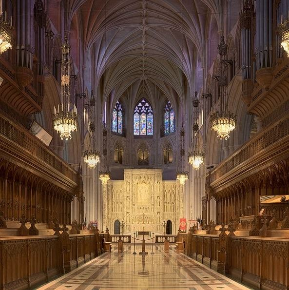 Photo: east end of the Washington National Cathedral, with the Ter Sanctus reredos, featuring 110 carved figures surrounding the central figure of Jesus