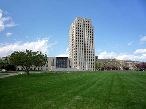 Photo: North Dakota State Capitol in Bismarck, North Dakota. Credit: Bobak Ha'Eri; Wikimedia Commons.