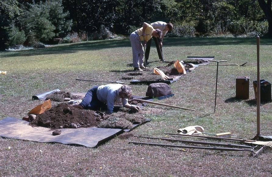 Photo: archaeologist Roland Robbins and volunteers probing the area to locate the Parris house foundation