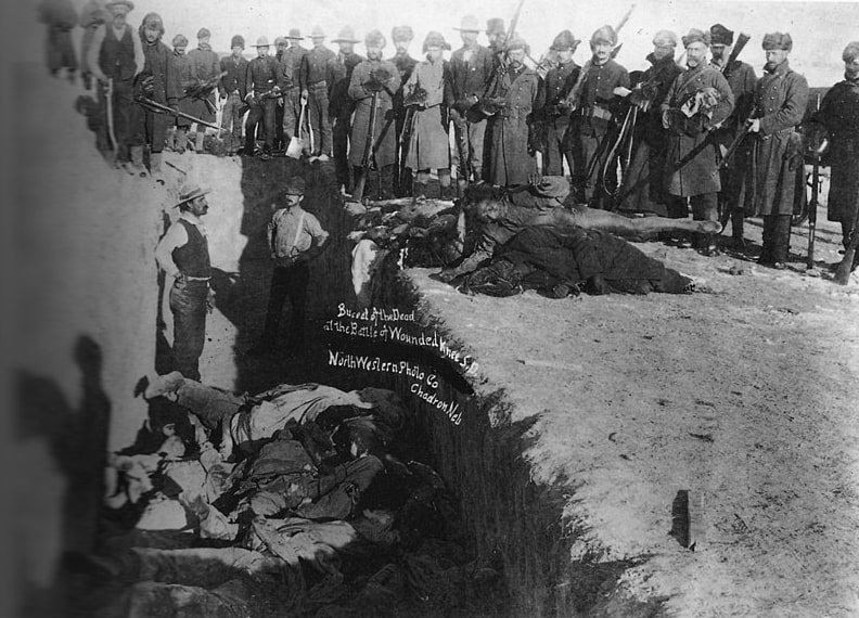 Photo: burial of the dead after the massacre of Wounded Knee, South Dakota