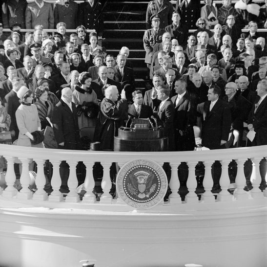Photo: Chief Justice Earl Warren administers the Presidential oath of office to John F. Kennedy at the Capitol, 20 January 1961