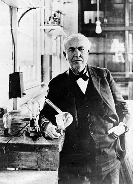 Photo: Thomas Edison with his invented white light bulbs from 1883