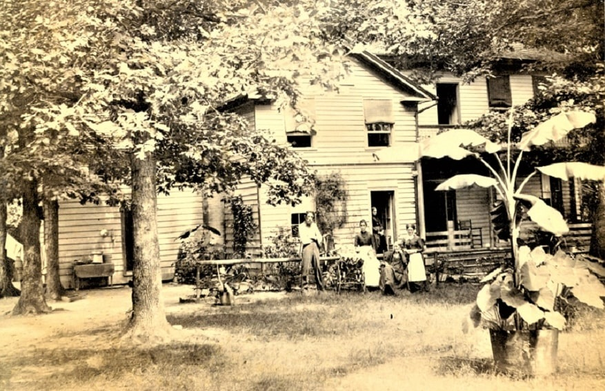 Photo: Gilman family in front of their house