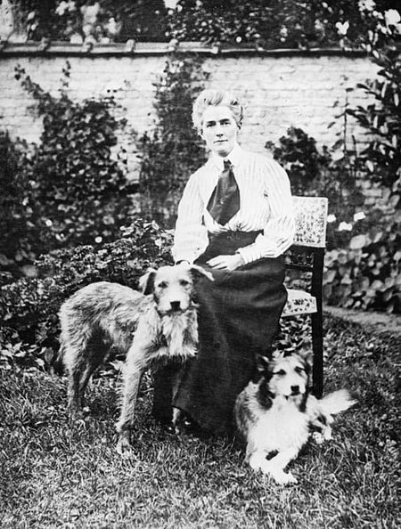 Photo: nurse Edith Cavell as she sits in a garden in Brussels, Belgium, with her two dogs before the outbreak of war