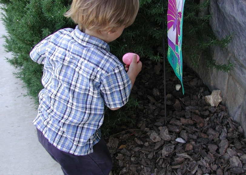 Photo: one of the author's children discovered a hidden egg during an Easter egg hunt