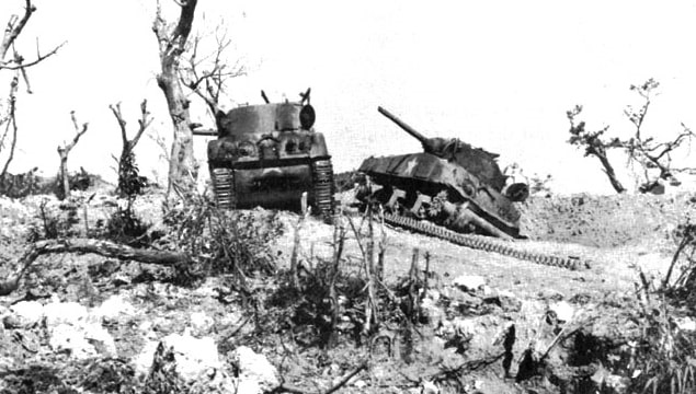 Photo: two U.S. M4 Sherman tanks knocked out by Japanese artillery at Bloody Ridge during the Battle of Okinawa, 20 April 1945