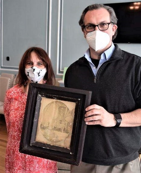 "Photo: ""Jill St. Onge, historian of Central Congregational Church in Newburyport, and the Rev. Christopher Ney show the 1861 framed photo left at the church by an anonymous donor."""