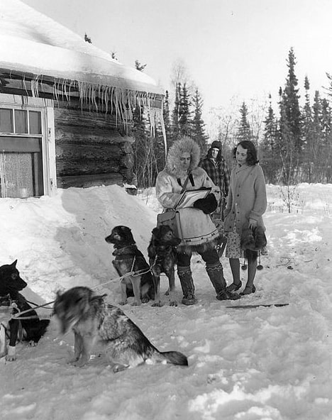 Photo: this 1940 Census publicity photo shows a census worker (left) collecting information from a respondent (right) in Fairbanks, Alaska. The dog musher (center, background) remains out of earshot to maintain confidentiality.