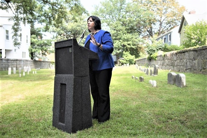 Photo: Salem Mayor Kim Driscoll speaks to residents and Quakers who attended the ceremony at the Quaker Cemetery, August 2019