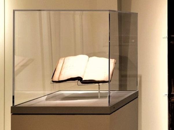Photo: Joshua Buffum's account book in a glass case. Credit: Peabody Essex Museum.