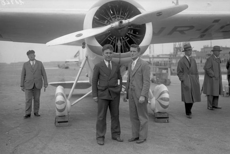 Photo: Wiley Post (left) with Harold Gatty in front of the Winnie Mae in Germany, June 1931