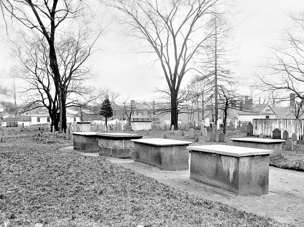 Photo: Burying Point Cemetery from Charter Street, Salem, Massachusetts. Courtesy of Peabody Essex Museum, Phillips Library, from the collection of Frank Cousins.