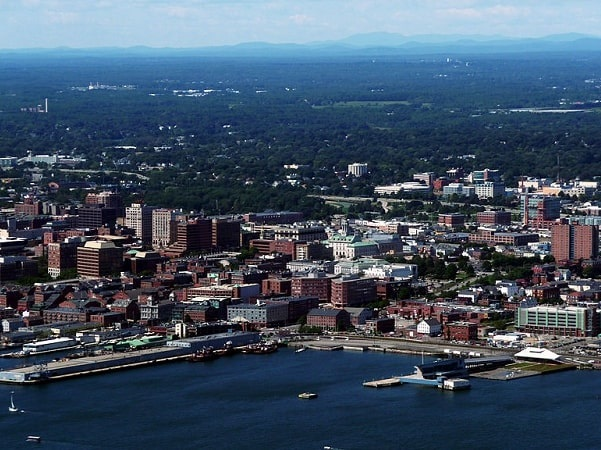 Photo: Old Port area of Portland, Maine, with the White Mountains visible in the background. Credit: Alex Boykov; Wikimedia Commons.