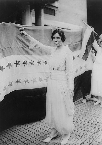 Photo: Alice Paul toasting (with grape juice) the recent passage of the Nineteenth Amendment, 3 September 1920