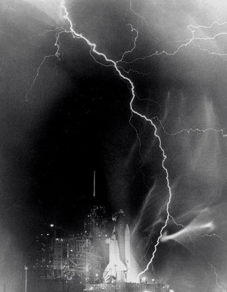 Photo: a powerful electrical storm created an eerie tapestry of light in the skies near Complex 39A in the hours preceding the launch of Challenger on mission STS-8 at 2:32 a.m. EDT, 30 August 1983