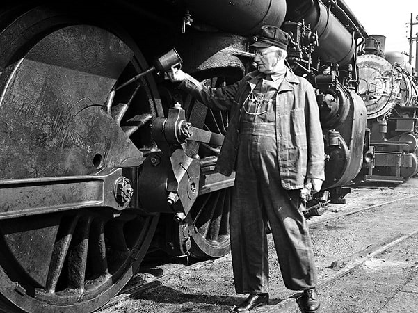 Photo: a railroad worker for the Southern Pacific Railroad Company. Credit: DeGolyer Library, Southern Methodist University; Flickr the Commons.