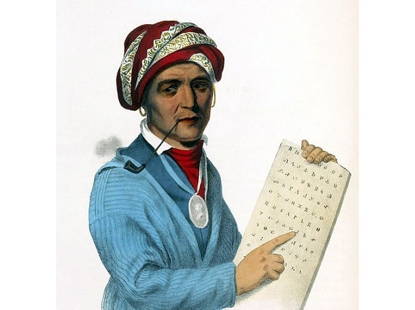 Illustration: Sequoyah with a writing tablet depicting his writing system for the Cherokee language. Credit: Wikimedia Commons.