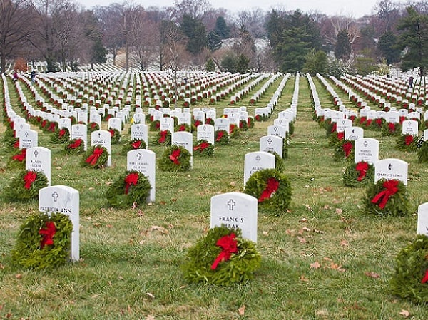 Photo: wreaths laid at headstones in Arlington National Cemetery