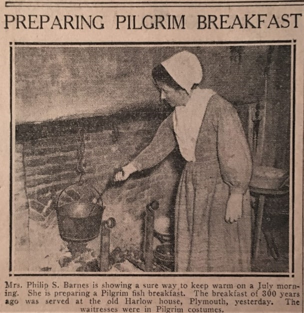"""Photo: Mrs. Mercie Hatch Barnes """"showing a sure way to keep warm on a July morning"""" while cooking over a fire at the Pilgrim Breakfast, c. 1940. Courtesy of Plymouth Antiquarian Society Archives, Plymouth, Massachusetts."""
